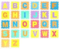 Figursåguppsättning med alfabet Arkivbild