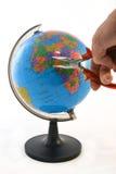Fijación del mundo con los alicates Imagen de archivo libre de regalías
