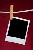 Fijación vieja del marco de la foto a rope Imágenes de archivo libres de regalías