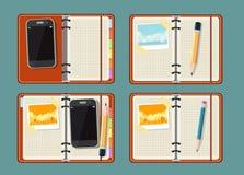 Fije con la libreta, el teléfono elegante, la foto y el reloj Imagenes de archivo