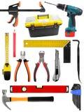 Fije con las herramientas de la construcción aisladas en blanco Imagen de archivo libre de regalías