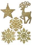 Fije de cinco decoraciones de la Navidad del oro aisladas en blanco fotos de archivo libres de regalías