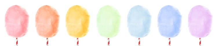 Fije de diverso caramelo de algodón delicioso colorido en el fondo blanco fotografía de archivo