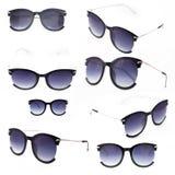 Fije de las gafas de sol de las mujeres con el soporte púrpura del tinte aislado frontal en un fondo blanco con una sombra imágenes de archivo libres de regalías