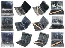 Fije de los ordenadores portátiles rotos viejos aislados en blanco imágenes de archivo libres de regalías