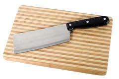 Fije el cuchillo en la tarjeta de corte Fotografía de archivo