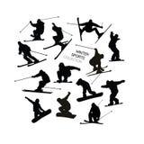 Fije la colección del esquiador alpino negro s y de siluetas de los snowboarders aisladas en el fondo blanco Imagenes de archivo