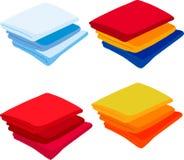 Fije las toallas coloreadas en el fondo blanco Foto de archivo libre de regalías