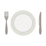 Fije para la comida, un cuchillo una bifurcación y una placa Imágenes de archivo libres de regalías