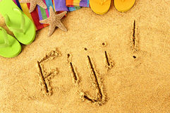 Fiji beach. Summer vacation sand word writing sign stock photography