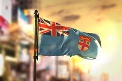 Fiji Flag Against City Blurred Background At Sunrise Backlight Royalty Free Stock Image