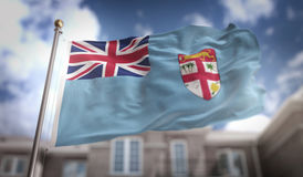 Fiji Flag 3D Rendering on Blue Sky Building Background Royalty Free Stock Photography