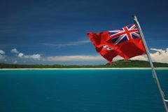Fiji Flag over blue lagoon Royalty Free Stock Photo