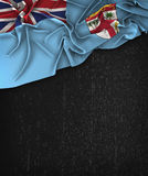 Fiji Flag Vintage on a Grunge Black Chalkboard With Space For Te Stock Image
