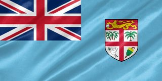 Fiji Flag. With waving on satin texture royalty free stock images