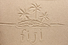 Fiji handwritten in sand for natural, symbol Stock Photo