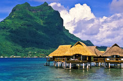 Fiji Island Huts. Luxury housing in huts on posts in Fiji Lagoon