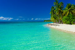 Fiji island with sandy beach and clear lagoon water Royalty Free Stock Photo