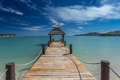 Fiji Pier with blue skies. Pier in Fiji in Musket Cove in Matamanoa island group royalty free stock photography