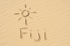 Fiji in the Sand. A picture of the sun and the word Fiji drawn in the sand Stock Photo