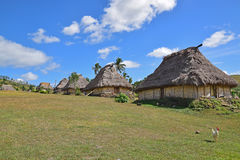 Fijian bure in on a rolling hill slope at Navala, a village in the Ba Highlands of northern central Viti Levu, Fiji. These houses are traditional fijian wood and Royalty Free Stock Images