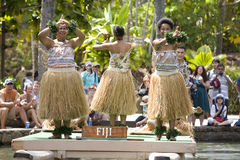 Fijian Dancers 1596. POLYNESIAN CULTURAL CENTER, OAHU, HI - JULY 26:  Students from Fiji perform traditional Fijian dances on a canoe.  Taken at the Rainbows of Stock Image