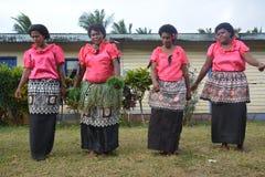 Fijian dancing women. A group og Fijian dancing women as part of a fokloristic show in their village Stock Image