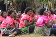 Fijian ensemble. A group og Fijian dancing women as part of a folkloristic  show in their village Royalty Free Stock Photos