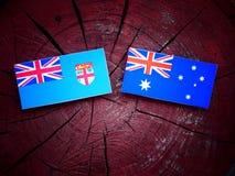 Fijian. Flag with Australian flag on a tree stump Royalty Free Stock Photo