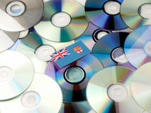 Fijian flag on top of CD and DVD pile isolated on white. Fijian flag on top of CD and DVD pile isolated Royalty Free Stock Images