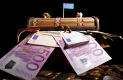 Fijian flag on top of crate. Full of money Stock Image