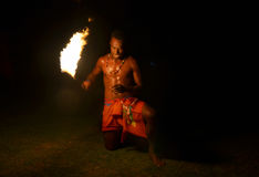 Fijian man holds a tourch during a fire dance Stock Images