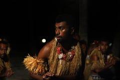 Fijian men dancing a traditional male dance meke wesi in Fiji Stock Photos