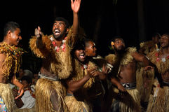 Fijian men dancing a traditional male dance meke wesi in Fiji. Indigenous Fijian men dancing a traditional male dance meke wesi the spear dance. Real people copy Royalty Free Stock Photos