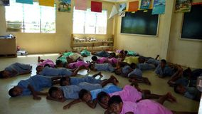Fijian school class sleeping on the ground Stock Photos