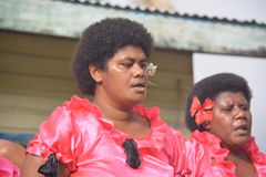 Fijian singers. Two Fijian local singers performing before an audience dressed by fancy Stock Photography