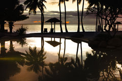 Fijian sunset. The sun setting to the west of a popular Denarau resort area bathed in golden light at sunset Royalty Free Stock Photos