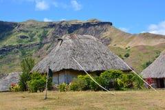 Fijian traditionally built houses. A common scene from the  traditionally built Fijian village called Navala Stock Image