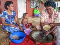 Fijian women making kava