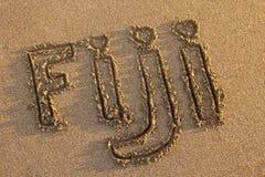 Fijianskt skriftligt för ord på en strand Arkivfoto