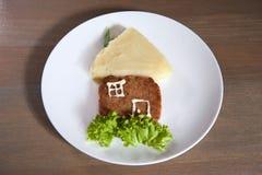 Fijngestampt aardappels en rundvleeslapje vlees Stock Afbeelding
