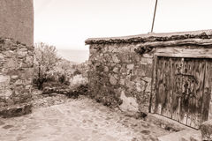 Fikardou village scene with blooming almond trees- sepia toned Stock Photos