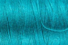 Fil de couture bleu d'essence Photographie stock libre de droits