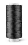 Fil noir sur la bobine verticalement Photo stock