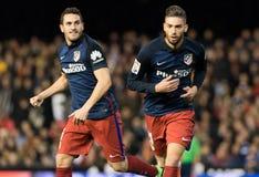 FIL VALENCIA ATLETICO. Yannick Carrasco and Koke Resurreccion of Atletico Madrid  celebrates the third goal during the La Liga match at Mestalla, Valencia Stock Image