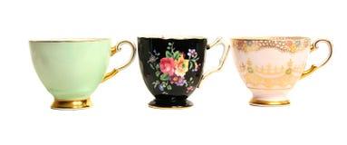 Fila antigua de las tazas de té Foto de archivo libre de regalías