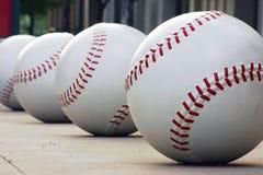 Fila de béisboles Foto de archivo