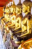 Fila de buddhas Imágenes de archivo libres de regalías