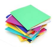 Fila de carpetas coloridas Foto de archivo libre de regalías