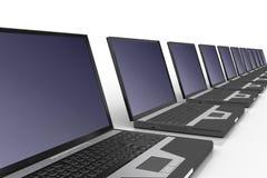 Fila de computadoras portátiles Imagen de archivo libre de regalías